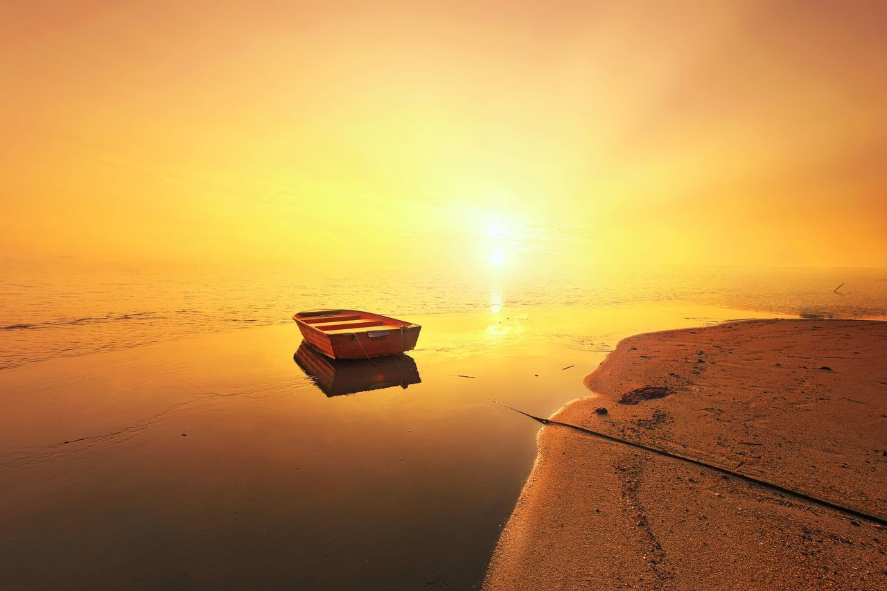 Reflections of boat and sunset at the beach Sunset Water Reflection Sky Sun No People Boat Nature Tranquility Beauty In Nature EyeEm Best Shots Travel Seascape Beach Landscape Island EyeEm Nature Lover EyeEm Gallery Long Exposure EyeEmBestPics Getty Images Getty X EyeEm Sea View Summer