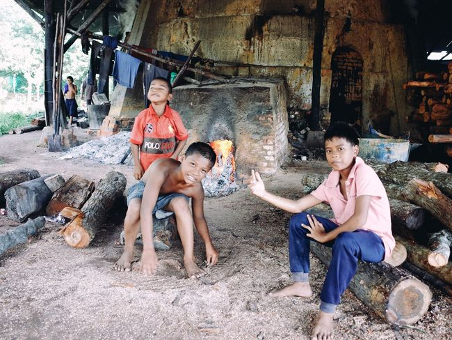 Childhood Full Length Togetherness Bonding Casual Clothing Person Sitting Elementary Age Playing Love Leisure Activity Lifestyles Day Outdoors Fun Innocence Charcoal Factory Streetmalaysia Streetphotography