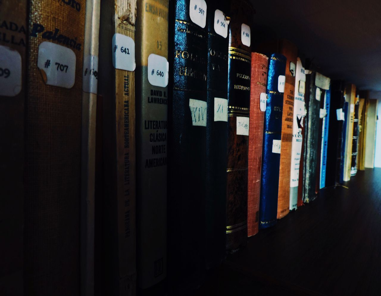 indoors, no people, collection, book, large group of objects, bookshelf, shelf, education, close-up, library, day