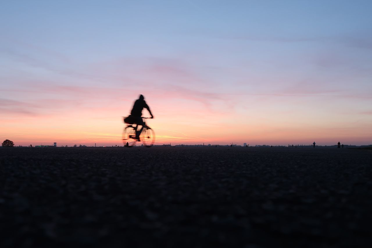 Capture Berlin Capture The Moment Cycling Full Length Motorcycle Racing One Person Outdoors Real People Riding Riding A Bike  Silhouette Sky Speed Sunset Tempelhofer Feld Transportation Travel
