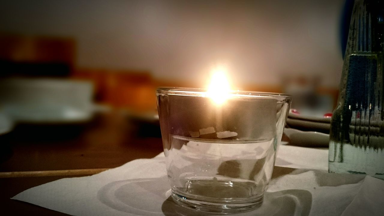 flame, table, candle, indoors, burning, close-up, no people, focus on foreground, day