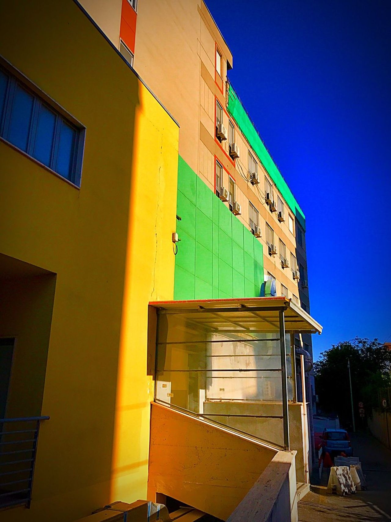Architecture Built Structure Building Exterior Outdoors No People Window Low Angle View Blue Day Clear Sky Multi Colored Yellow Sky Awning