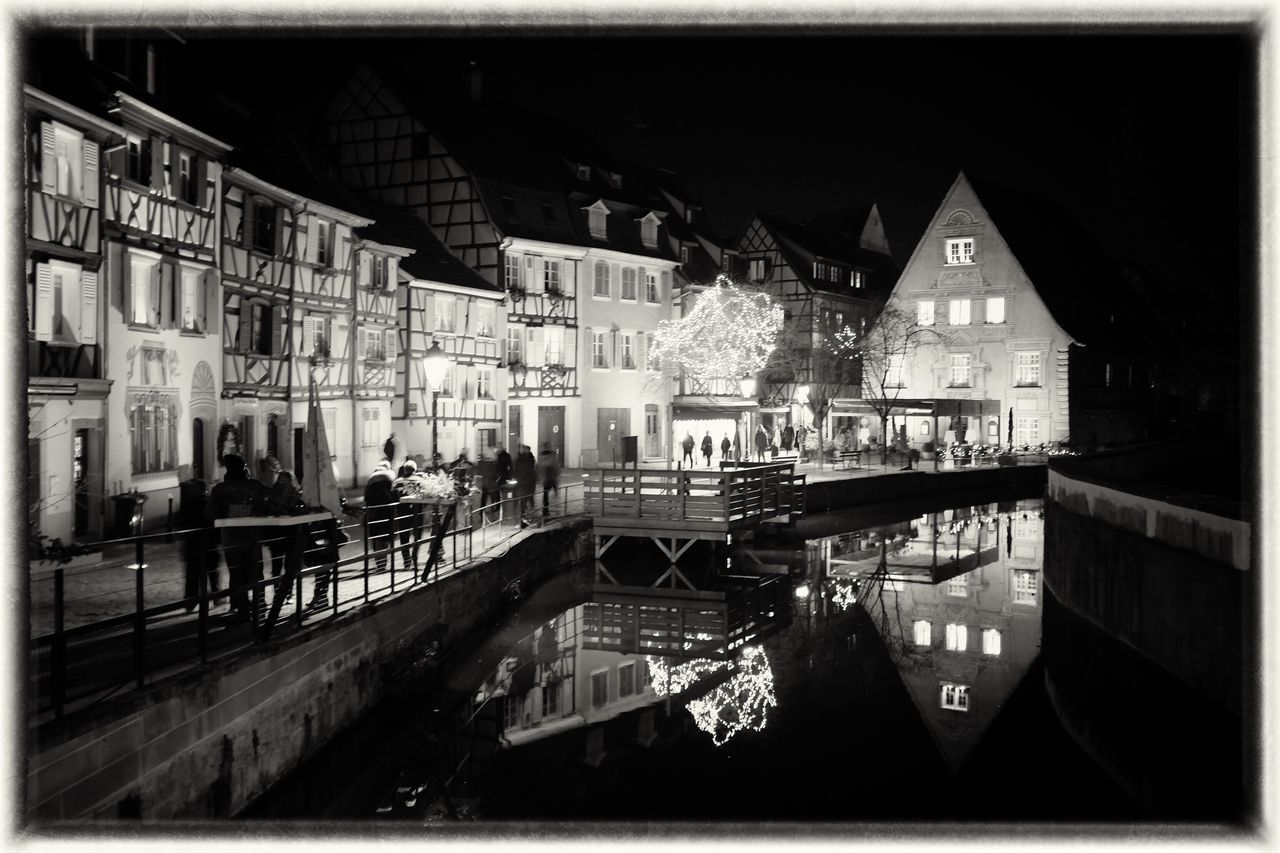 Night in Alsace Architecture Travel Destinations Canal Christmas Around The World Streetphotography Film Noir Colmar Alsace Black & White Up Close Street Photography Streetphoto_bw Christmas Decorations Illuminated Tree Reflection Water