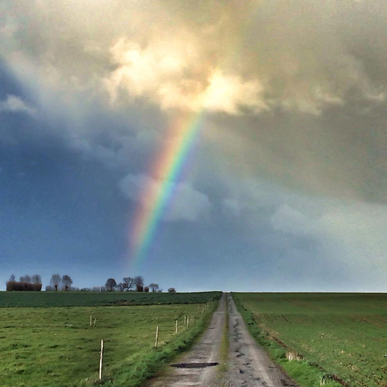 Dirt road and beautiful rainbow
