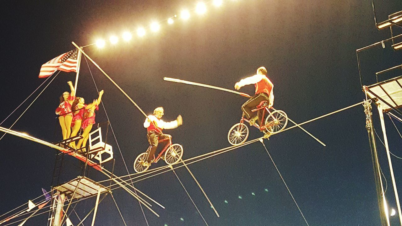 FairSeason in New England. The eponymous Flying Wallendas Riding Bicycles on the High Wire at The Guilford Fair