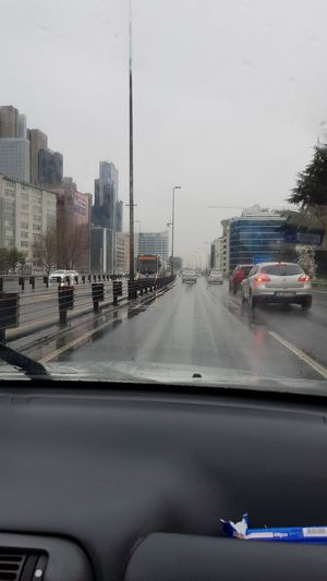 Rainy Days Voyage Exploring Traveladdicted Car Car Transportation Mode Of Transport Land Vehicle Wet Car Interior Windshield Water City Cityscape No People Architecture Day Sky Mobility In Mega Cities