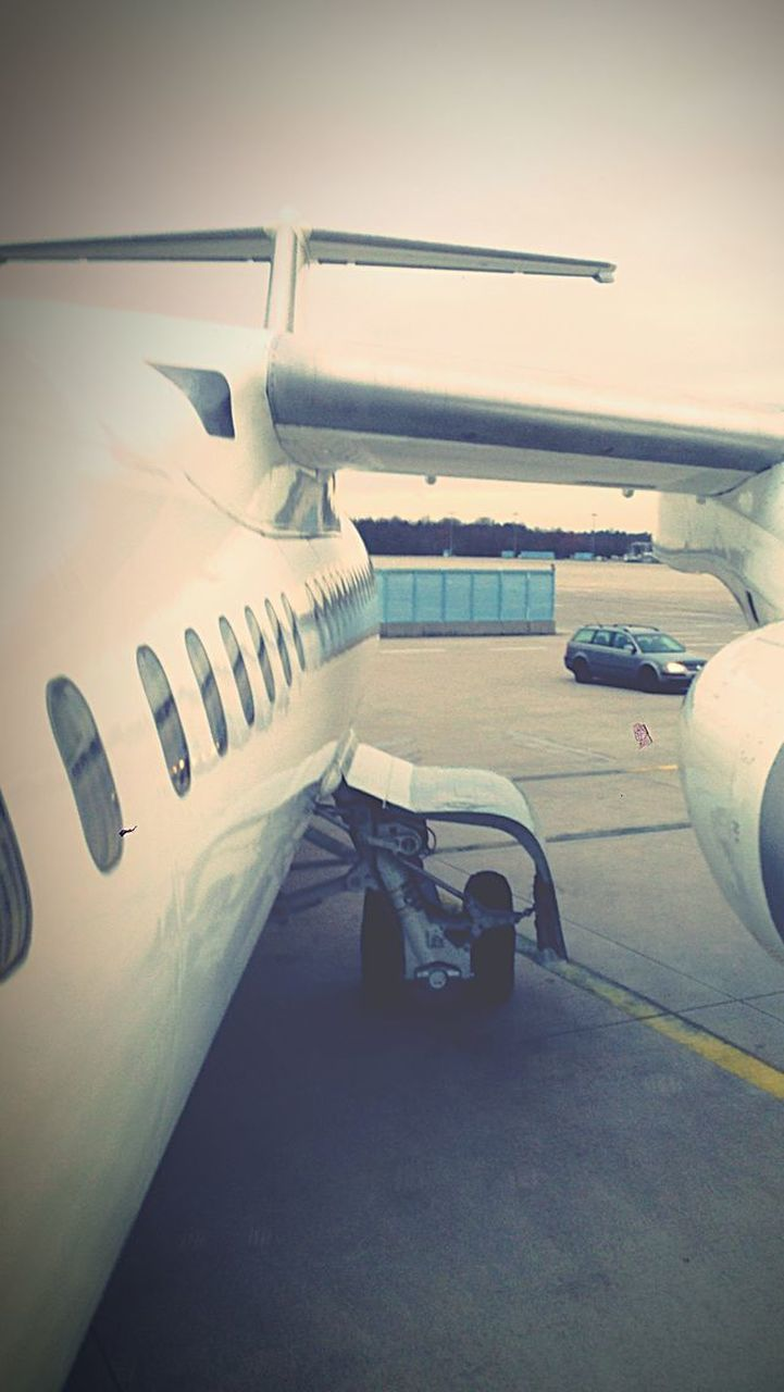 airplane, transportation, air vehicle, mode of transport, airport, airport runway, day, runway, one person, outdoors, men, sky, airplane wing, people