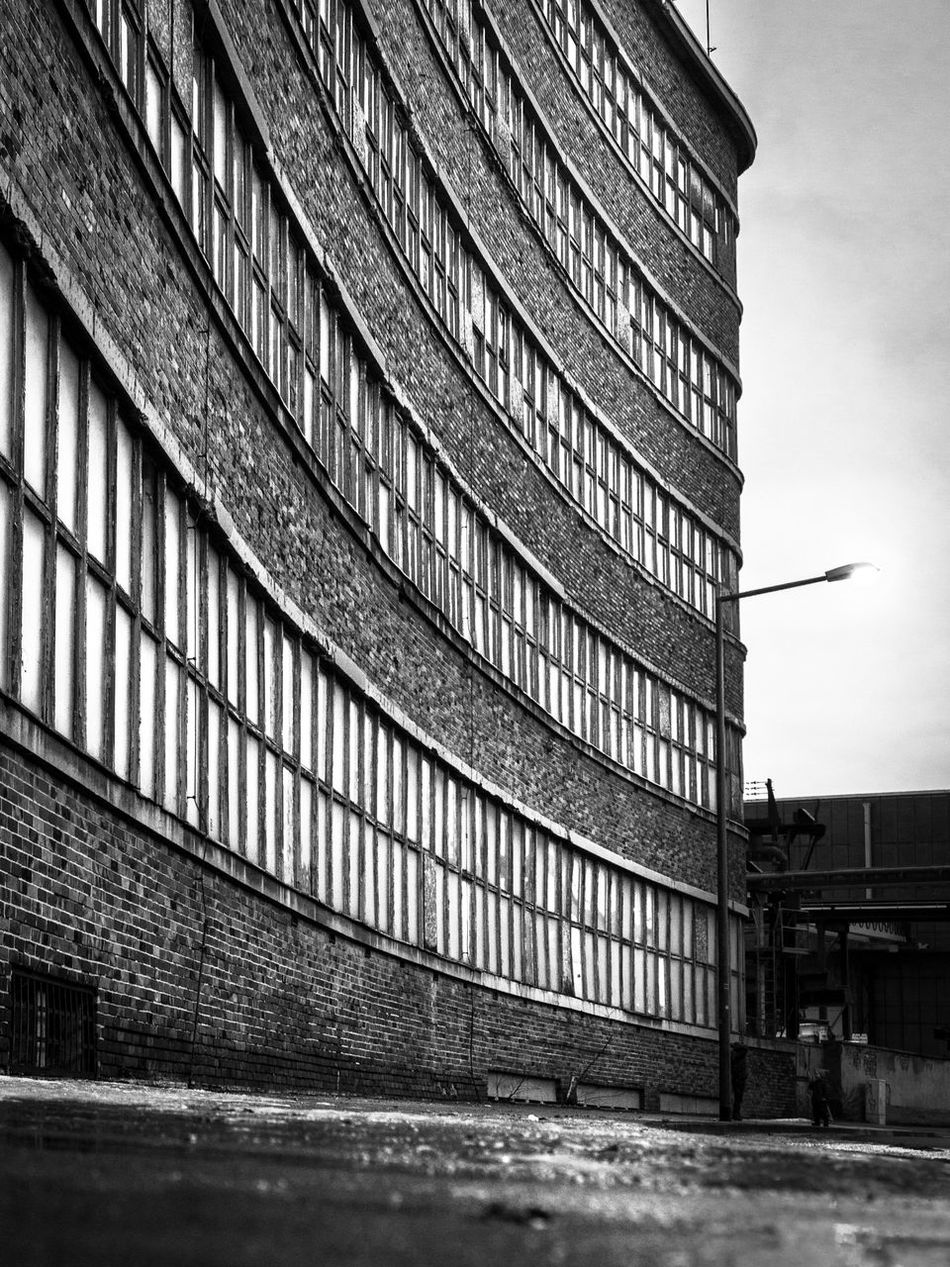 Architecture Blackandwhite Bricks Building Exterior Built Structure City Day EyeEm Best Shots EyeEm Best Shots - Black + White Fortheloveofblackandwhite Geometry Industrial Industrial Landscapes Industry Leading Lines Low Angle View Modern Monochrome No People Street Streetphotography Urban Urban Geometry Wall Windows