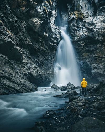 Chasing Waterfalls Scale  Schweiz Beauty In Nature Blurred Motion Cliff Day Human Kandertal Long Exposure Longexposure Motion Nature Outdoors Pochtenfall Power In Nature Rock - Object Rock Formation Scenics Switzerland Water Waterfall Yellow Raincoat Lost In The Landscape