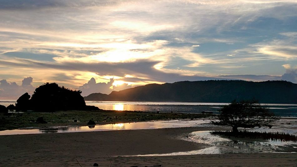 INDONESIA Kuta Lombok Sunset Sea Sea And Sky Beach Tranquil Scene Tranquility Mountain Shore Sand Vacations Water