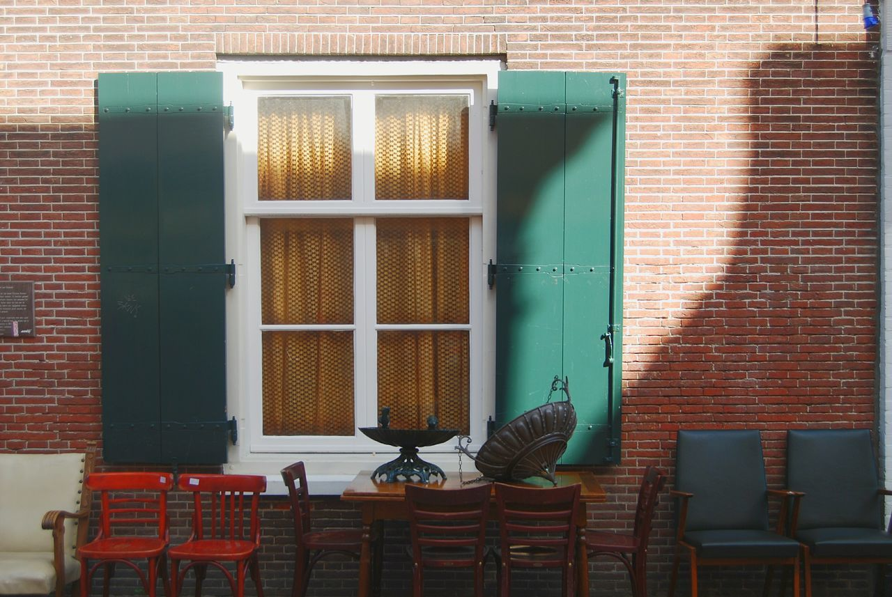 Urban Antiques Chairs Building Architecture Dutch Architecture Dutch Cities Cityscapes Netherlands Nederland Leiden Bright Colors Sunny Yellow Brick Wall Brick Green Window Junk Nikon Secondhand Travel Travel Photography