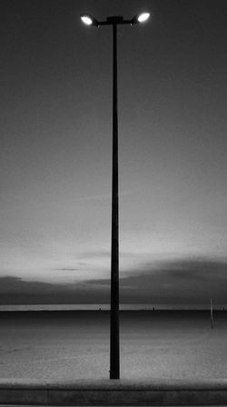 Streetlight. Street Light Illuminated Clear Sky Tranquility Tranquil Scene Electric Light No People Sea Ocean Black And White València SPAIN España Black & White Blanco Y Negro Black And White Photography Tall - High Tranquility Symmetry