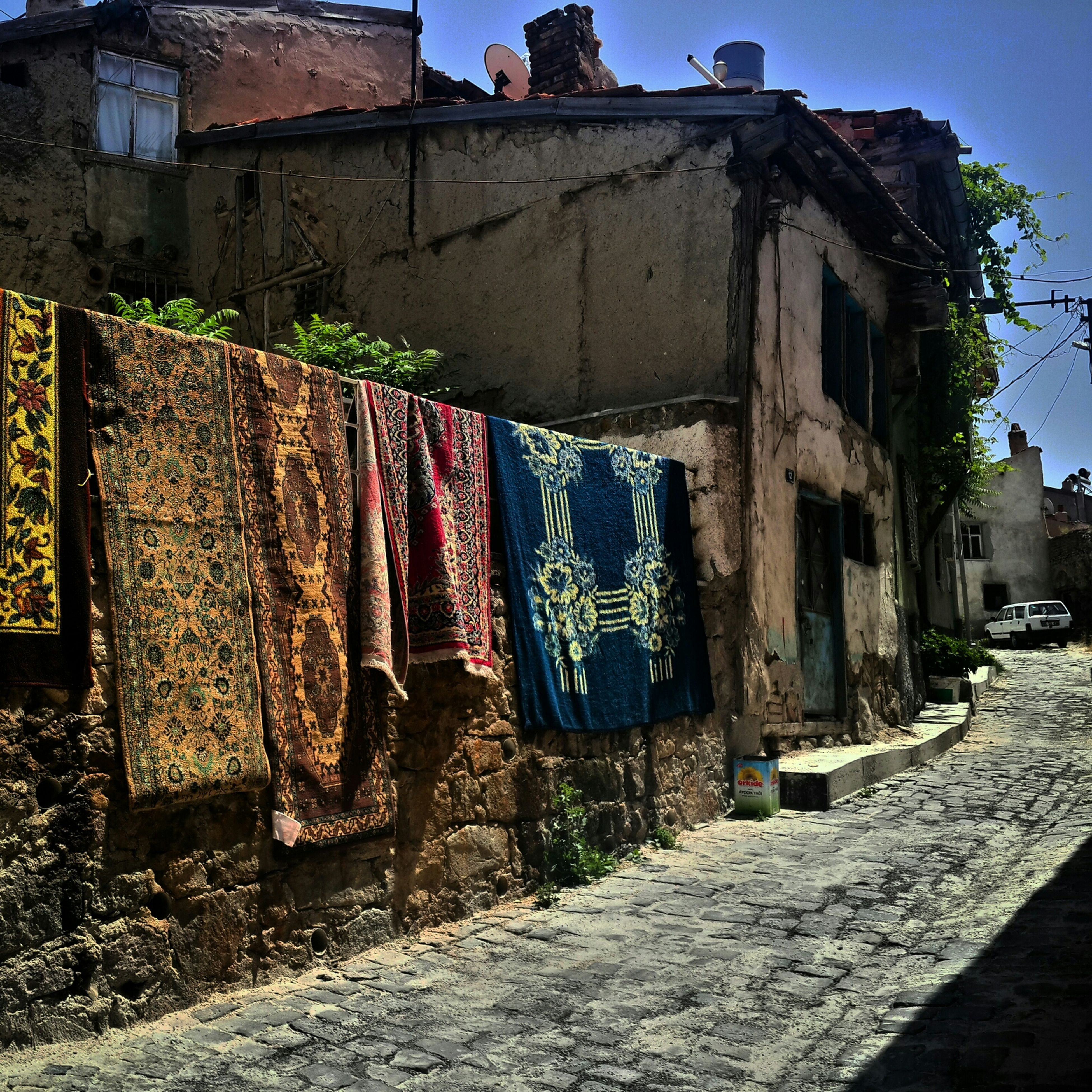 architecture, built structure, building exterior, old, abandoned, house, damaged, weathered, wall - building feature, building, blue, obsolete, sunlight, run-down, street, residential building, deterioration, residential structure, day, outdoors