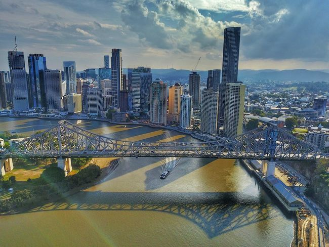 Scorching sun on a Brisbane Winter afternoon. Even the ferry seeks some shade! Built Structure Skyscraper Building Exterior City Cityscape River Connection Bridge - Man Made Structure Water Travel Destinations Outdoors Sky No People Day Urban Skyline Modern Mavic Pro Dronephotography Cityscape Brisbane Brisbane City Storybridge