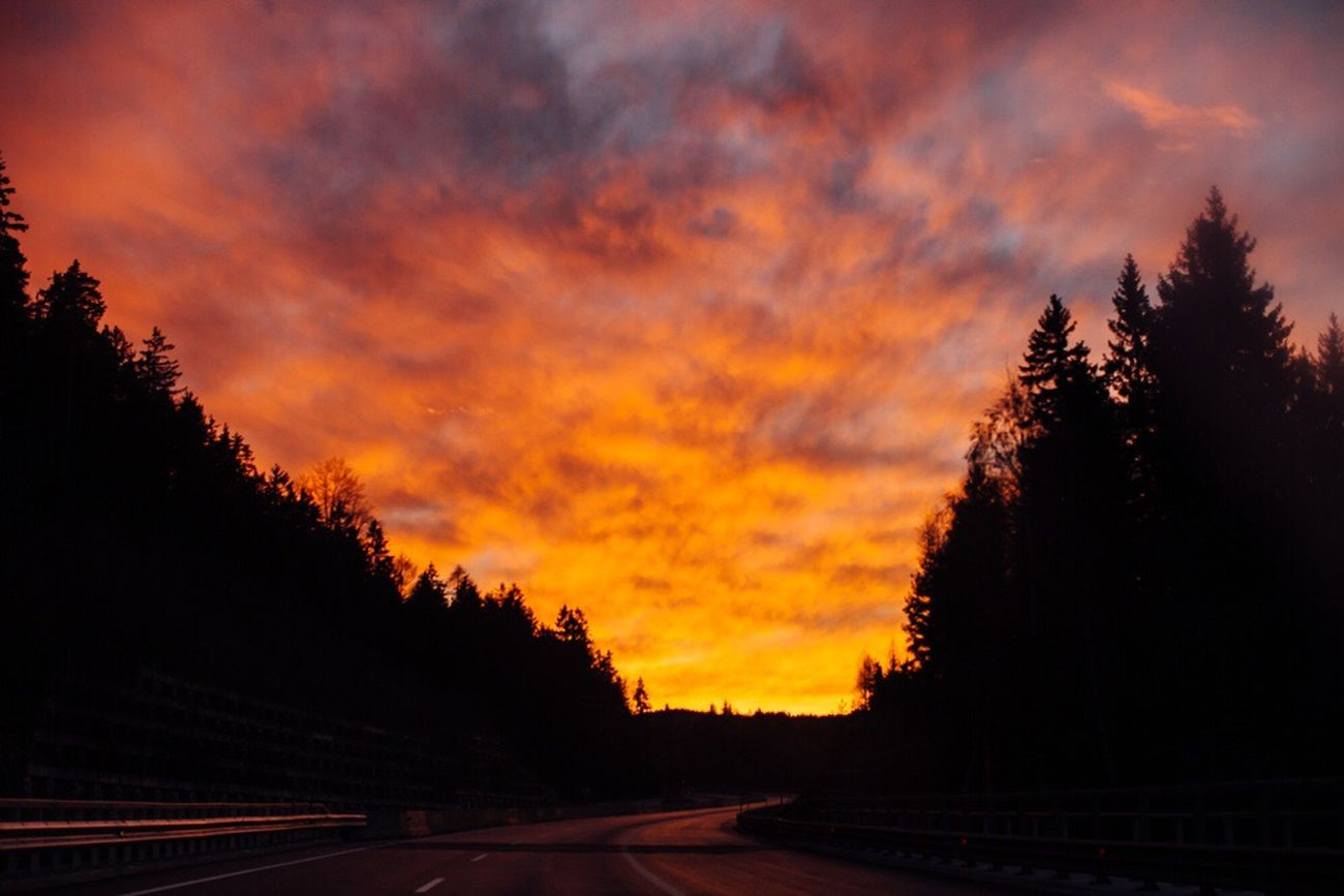 Sunset Orange Color Road Sky Cloud - Sky Dramatic Sky No People Beauty In Nature Outdoors The Way Forward Drivebyphotography Driving Snapshots Of Life Winter Road Canonphotography On The Road Transportation Tranquility The Great Outdoors - 2017 EyeEm Awards