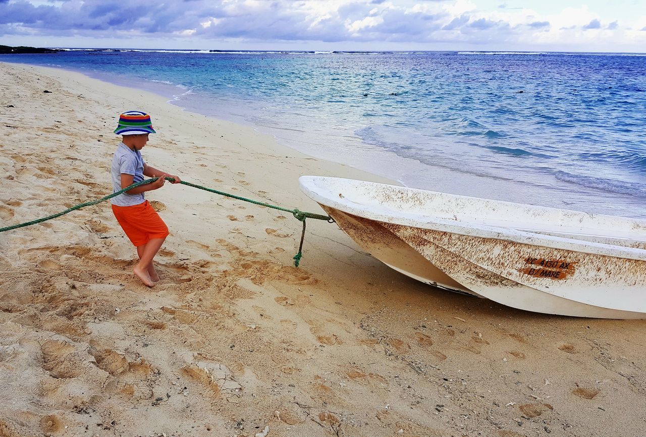 Beach Sand Sea Water Sky Day Outdoors Real People One Person Nature Full Length Horizon Over Water Vacations Lifestyles Scenics Beauty In Nature People Boy Ship Boat