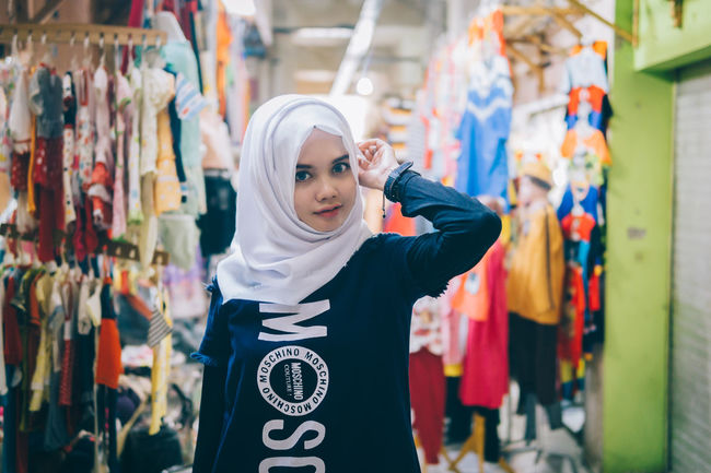 Focus On Foreground Casual Clothing Person Day Girl Mood Young Adult People People And Places Portrait Of A Woman Fashion Hijab Outdoors Looking At Camera Young Women Portrait Standing Fashionable Smile Beautiful Market
