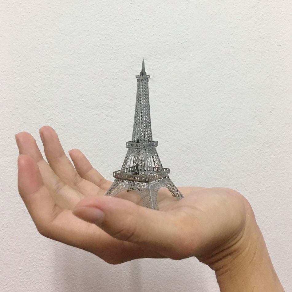 Mode Model Of City Human Hand Human Body Part One Person Holding Built Structure Architecture Studio Shot White Background People Adults Only Adult Outdoors Day Famous Place Famous Places Landmark Landmarkbuildings Tower Paris Paris, France  Paris Signs Symbol Of Paris Place Of Worship