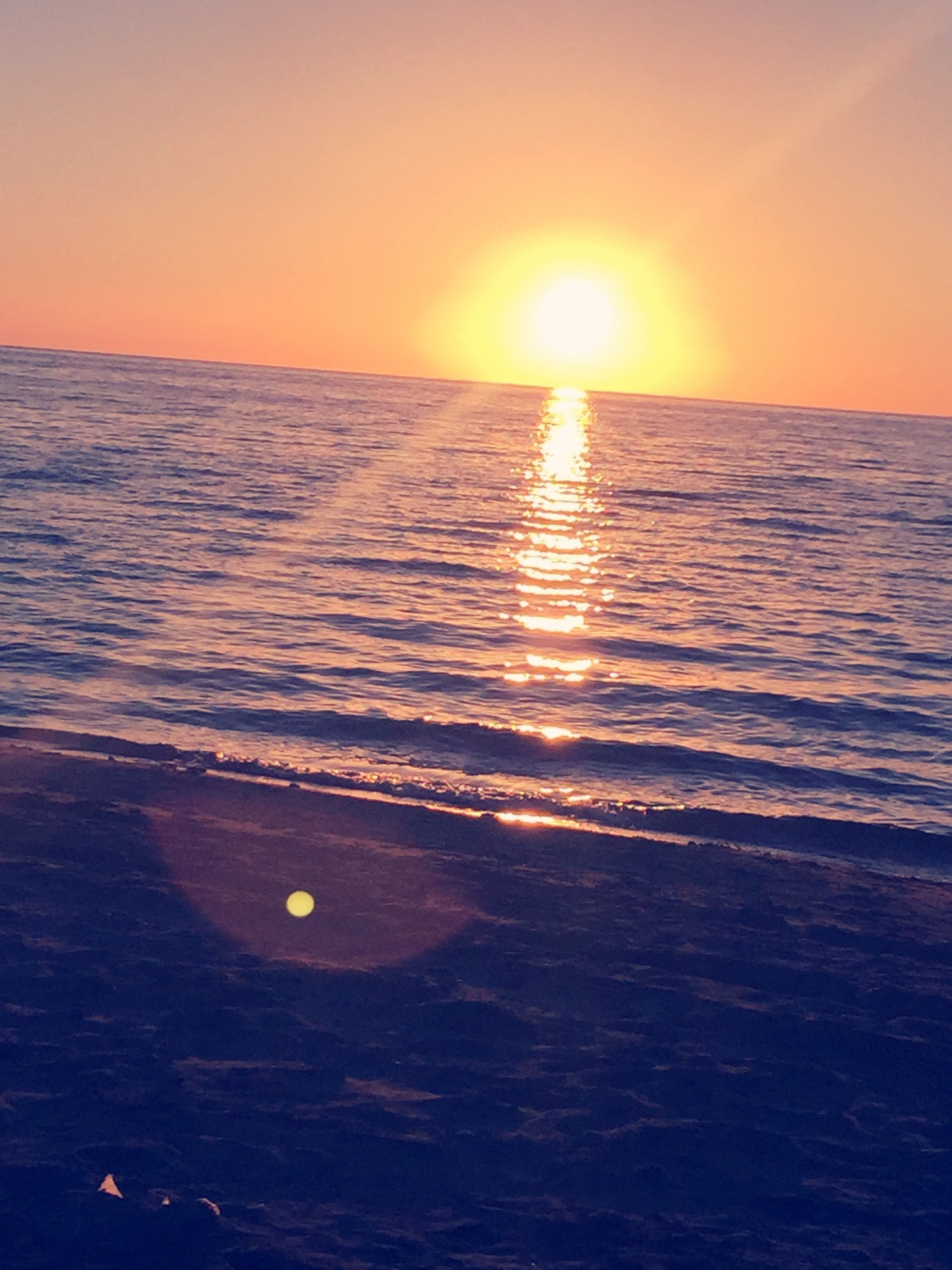 water, sunset, sea, sun, scenics, tranquil scene, horizon over water, beauty in nature, reflection, tranquility, orange color, rippled, waterfront, idyllic, nature, sunlight, clear sky, sky, seascape, outdoors