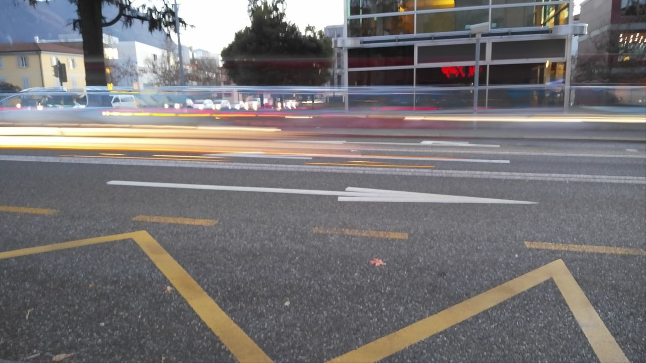Fast car passing by a street Fast Car Speed Car Race Go Fast Going Fast Street Light Transportation City Street Cars