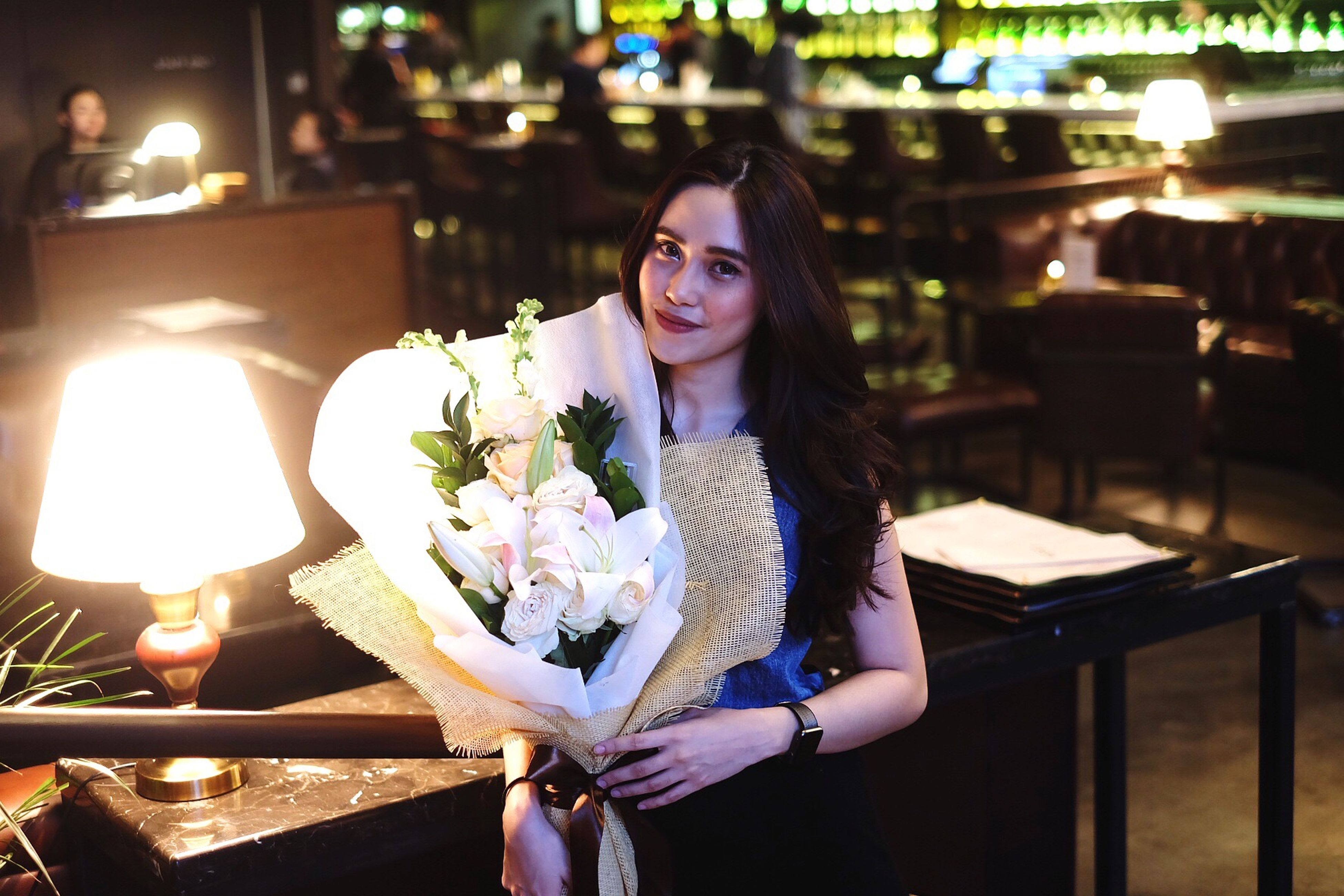 young adult, one person, table, restaurant, young women, portrait, night, front view, real people, flower, looking at camera, beautiful woman, smiling, happiness, illuminated, lifestyles, outdoors, nature, people
