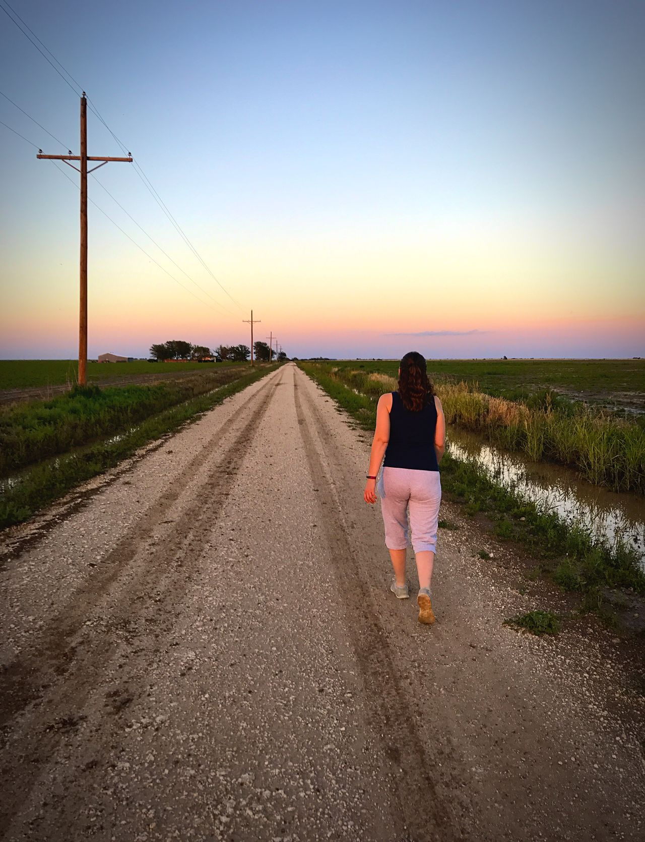 """""""The Long Way Home"""" Down a country road, beside the cottonfields, into a West Texas sunset. One Person The Way Forward Sunset Walking Real People Lifestyles Outdoors Road Scenics Adult People Sky West Texas Sunset Cottonfields West Texas Skies West Texas Rural Scene Rural Road Countryside Countryroads"""