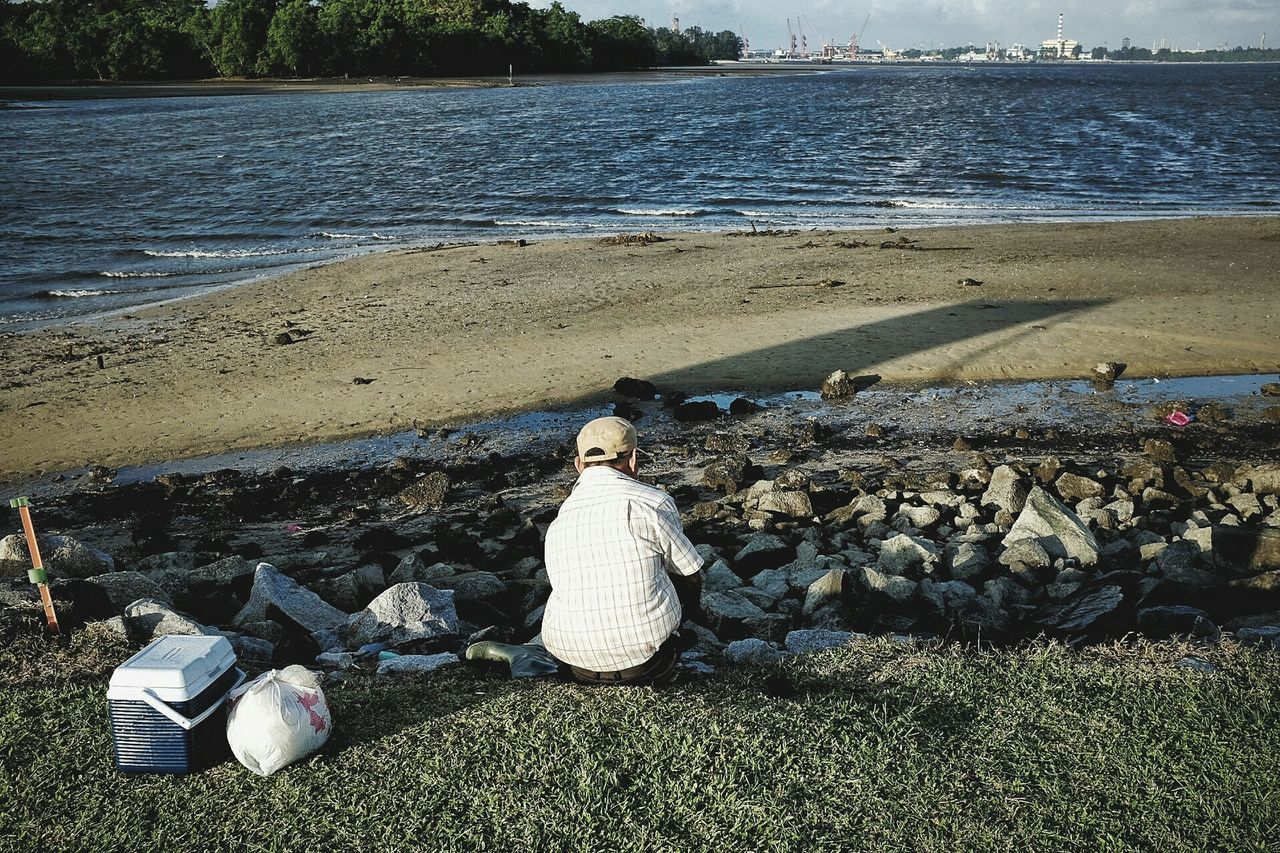 Admiring wonders of nature. Sunlight Outdoors Nature SingaporeUrban Exploration Life Elderly Tropical Climate Streetphotography Rocks Sand Beauty In Nature Nature Sea Refinery Water Back Shot  Old Man