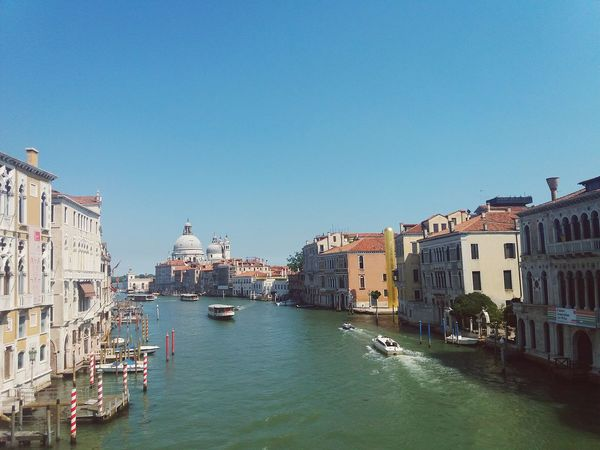 EyeEm Selects venice Architecture Tourism City Travel Destinations Vacations Water Cityscape Outdoors No People Clear Sky Gondola - Traditional Boat Sky Day Blue Tranquil Scene Beauty Love Happiness Diversity Venice Venice, Italy Venice Canals