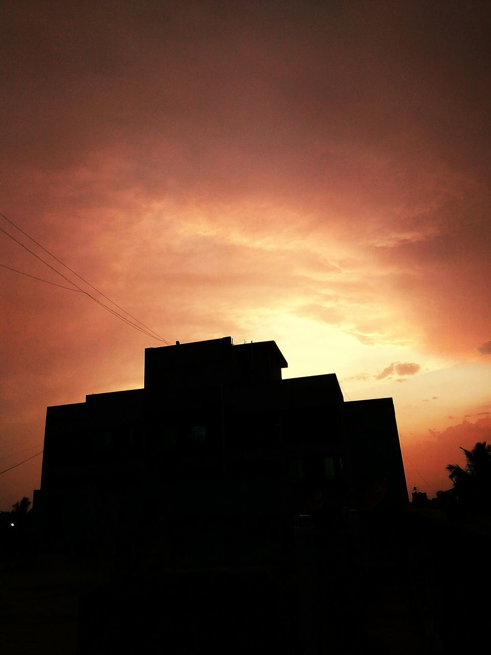 sunset, silhouette, architecture, building exterior, built structure, sky, no people, city, low angle view, outdoors, modern, nature