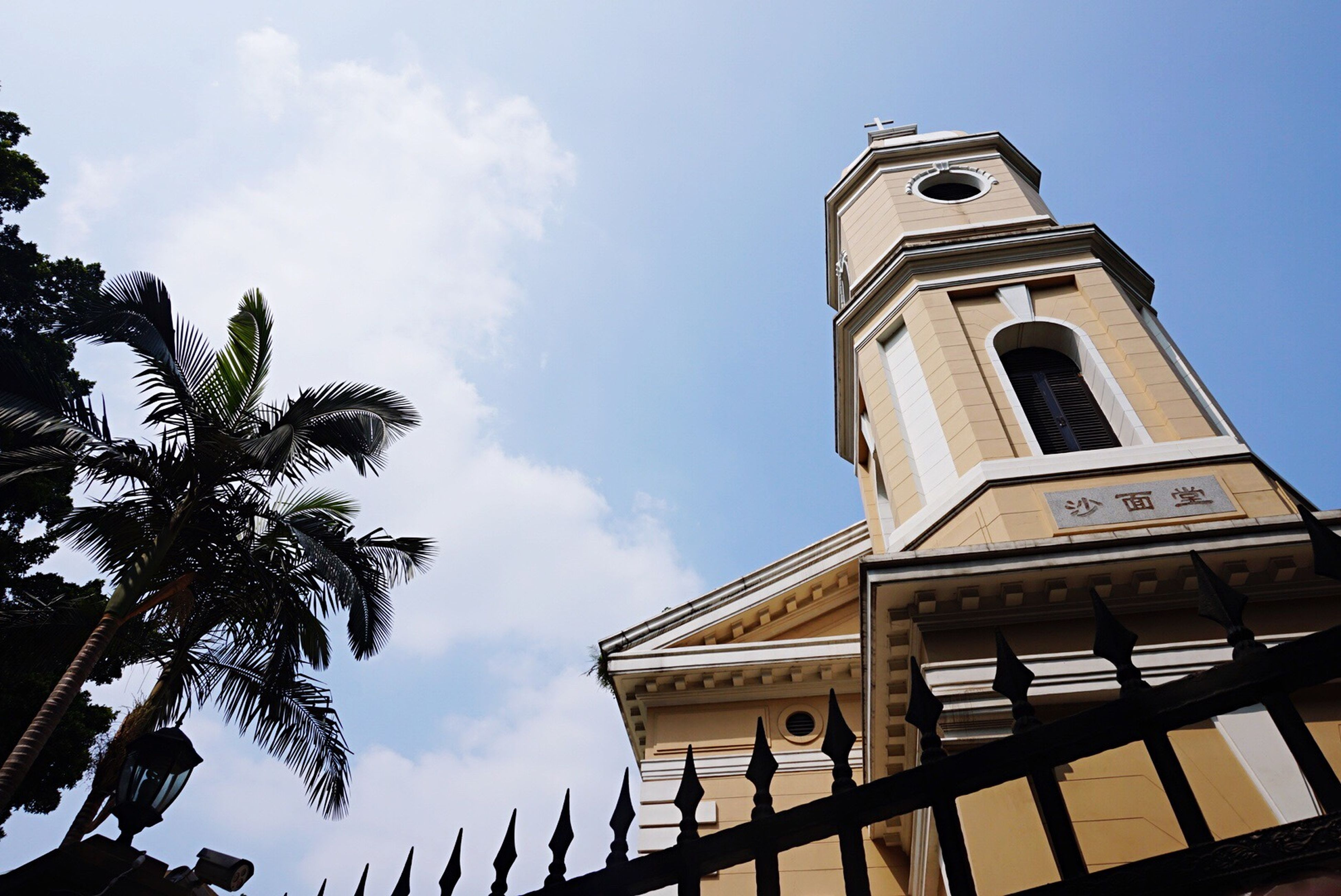 low angle view, architecture, built structure, building exterior, sky, church, religion, place of worship, tower, spirituality, clock tower, high section, history, window, day, no people, outdoors, tree