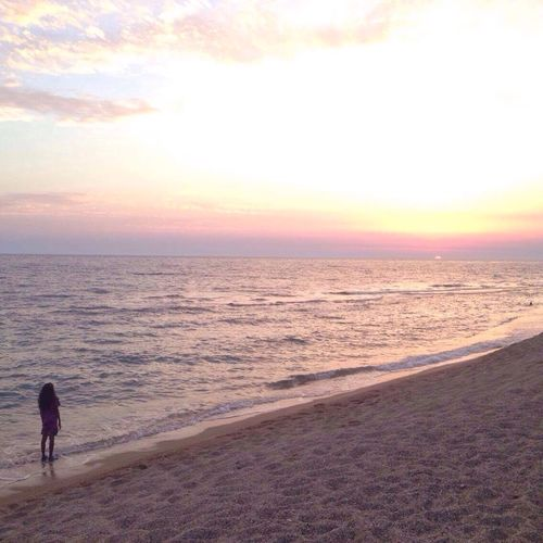 Sea Sunset Beach Horizon Over Water Scenics Beauty In Nature Water Nature Sky Sand Real People One Person Tranquil Scene Leisure Activity Outdoors Lifestyles Tranquility Vacations Men Full Length