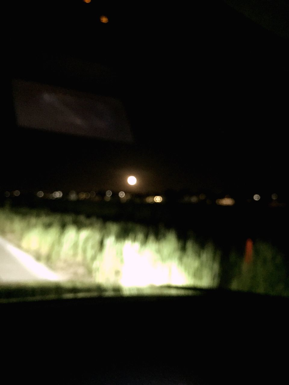 night, illuminated, lens flare, lighting equipment, transportation, no people, car, road, outdoors, defocused, nature, sky, beauty in nature, close-up