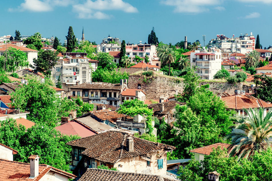 Antalya cityscape. Turkish resort Antalya Turkey Architecture ASIA Blue Sky Building Exterior City Cityscape Houses Landscape Middle East Nature Outdoors Palm Trees Rooftops Scenery South Summer Tourism Town Travel Destinations Trees Tropical Climate Turkey Turkish Riviera Urban Landscape