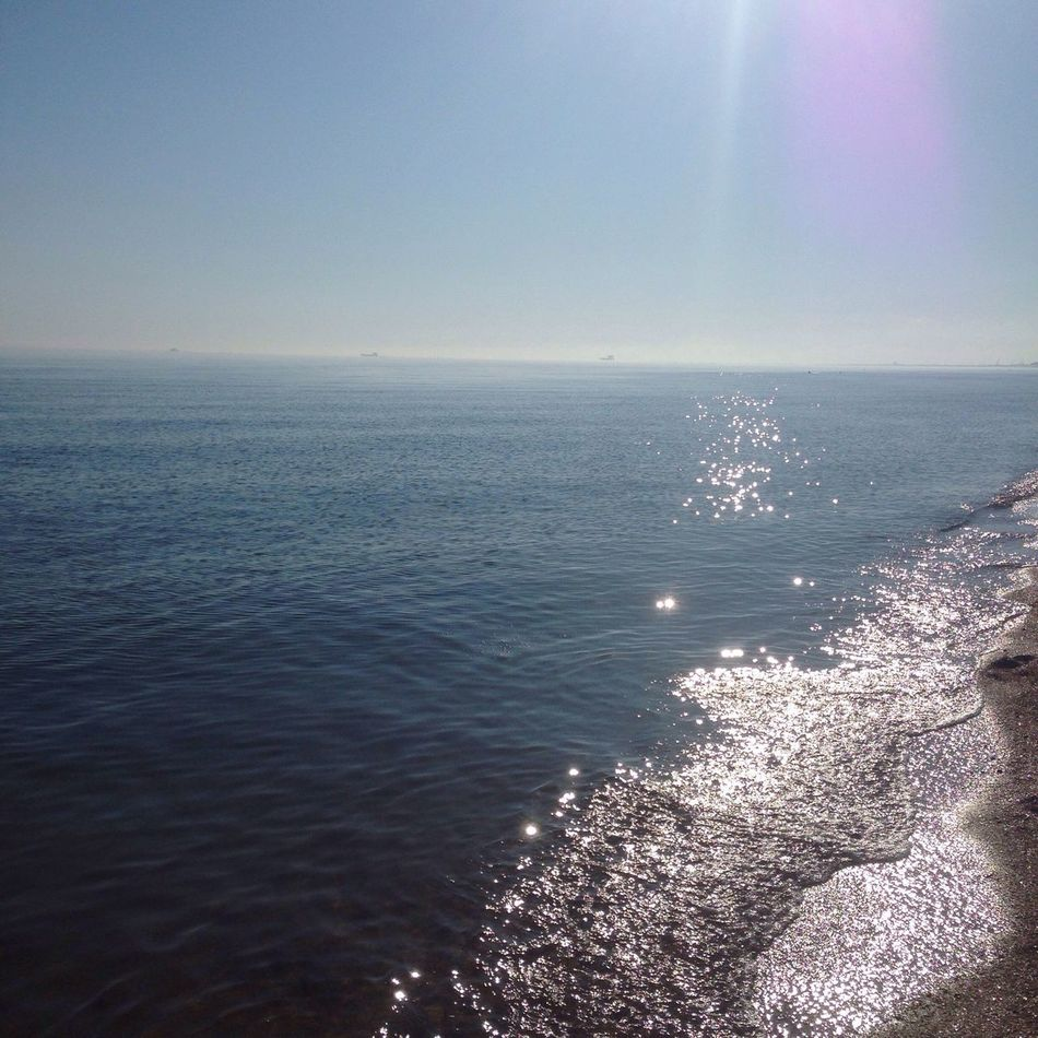 Sea Horizon Over Water Water Beauty In Nature Nature Scenics Sunlight Tranquility Tranquil Scene Outdoors Beach Day Sky No People Wake - Water