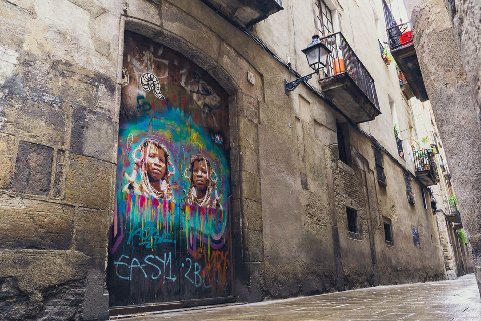 Alley Angles Architecture Art And Craft Barcelona Barcelona, Spain Barcelonalove Building Exterior Built Structure Day Female Likeness Graffiti Graffiti & Streetart Graffiti Art Graffiti Wall Human Representation Multi Colored No People Outdoors Perspective SPAIN Travel Travel Photography Wanderlust Water