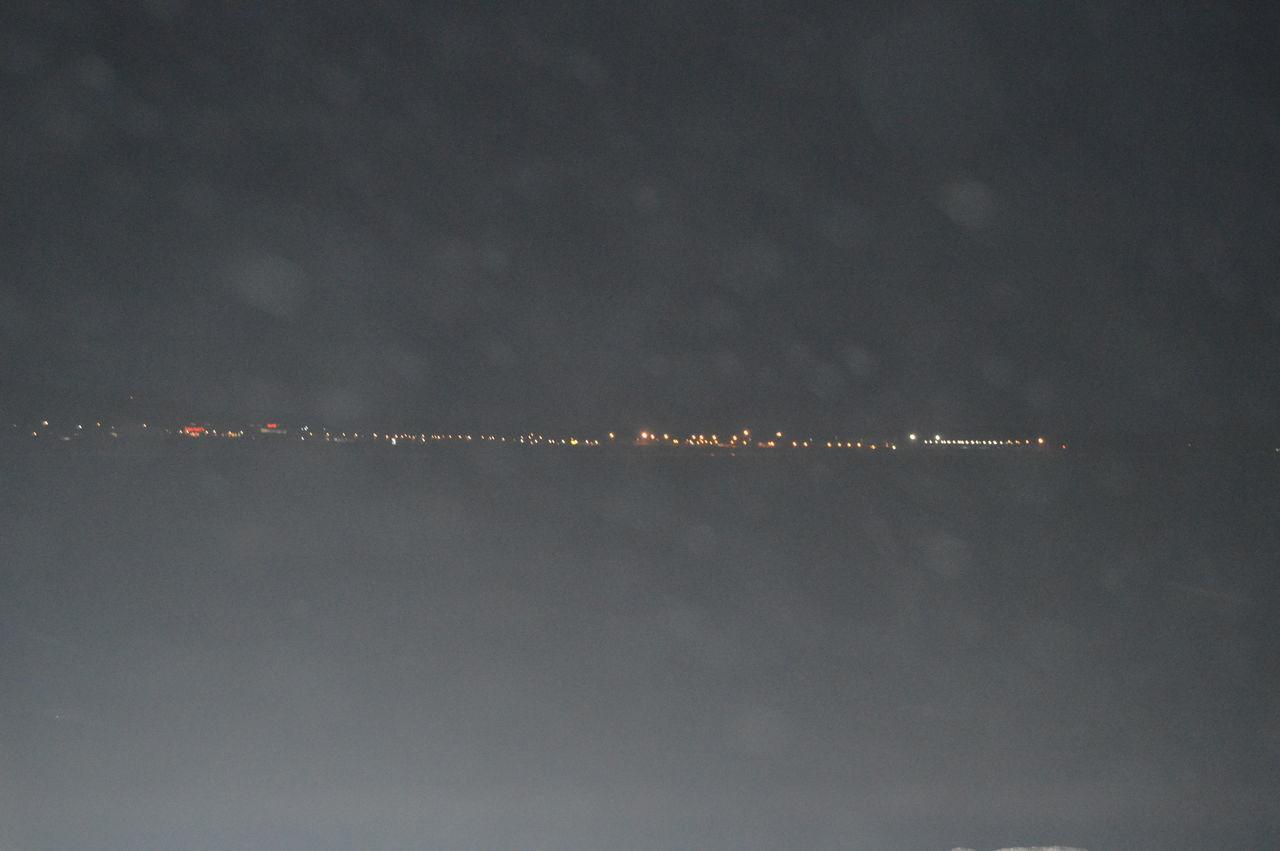 Defocused Illuminated Night Ocean Life Sea Ship Lights Water