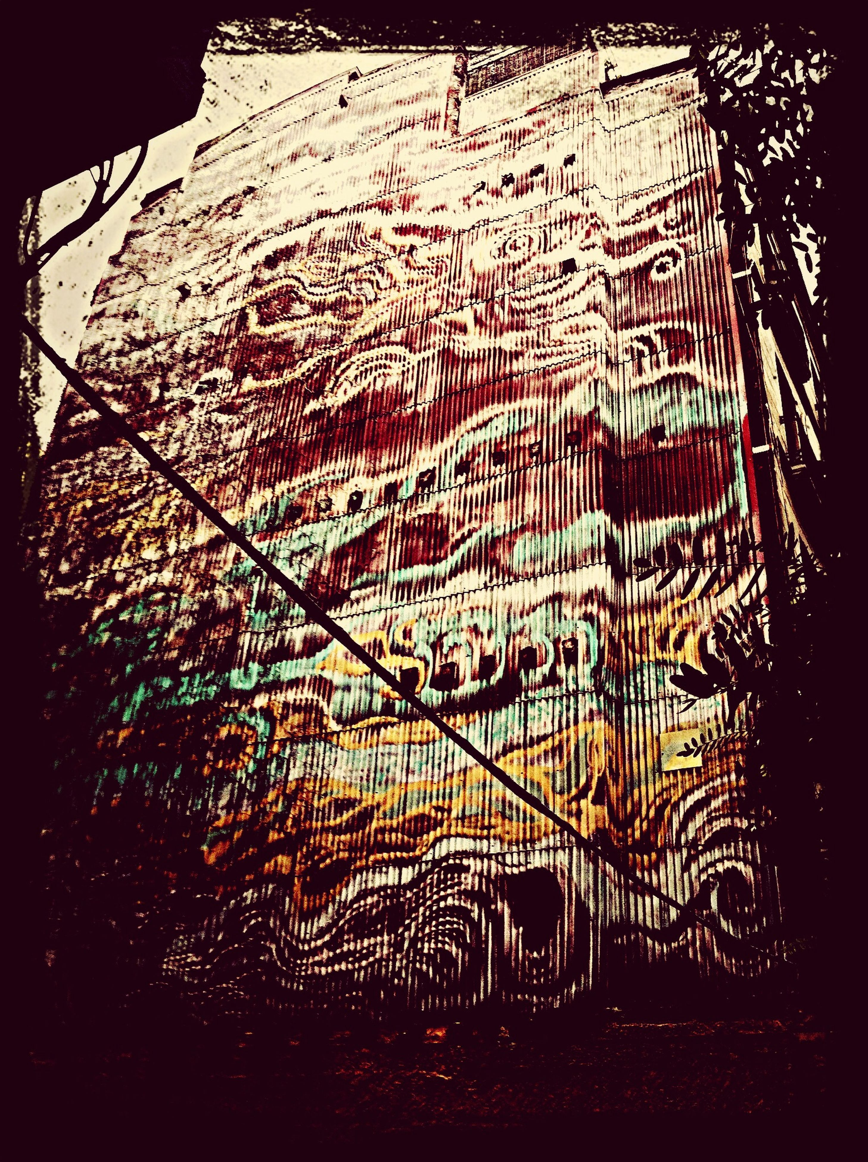 built structure, architecture, pattern, graffiti, auto post production filter, night, the way forward, no people, outdoors, wall - building feature, transfer print, railing, building exterior, design, illuminated, fence, art, low angle view, multi colored