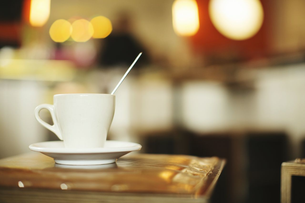 Close-up Cafe Drink Food And Drink Cup Table No People Indoors  Light Brown Cup Of Coffee Coffecup Coffee Shop Coffee Time Coffee Break Wood - Material Coffee Cappuccino Espresso Coffee - Drink Coffee Cup