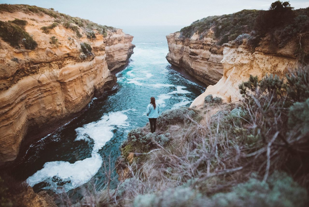 Rock - Object Rock Formation Nature One Person Leisure Activity Real People Adventure Full Length Beauty In Nature Rear View Standing Day Scenics Outdoors Tranquility Cliff Water Landscape Lifestyles Sea Great Ocean Road, Australia Nature Fresh On Market 2017