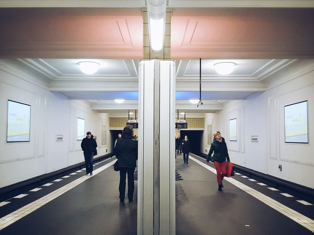 indoors, men, real people, full length, illuminated, walking, women, transportation, architecture, day, people