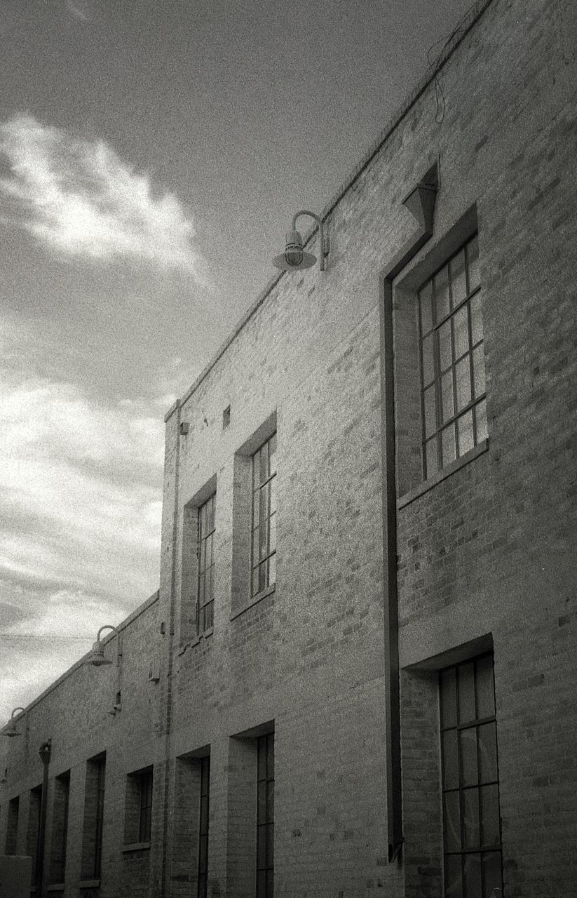 building exterior, architecture, built structure, window, low angle view, sky, no people, outdoors, cloud - sky, day