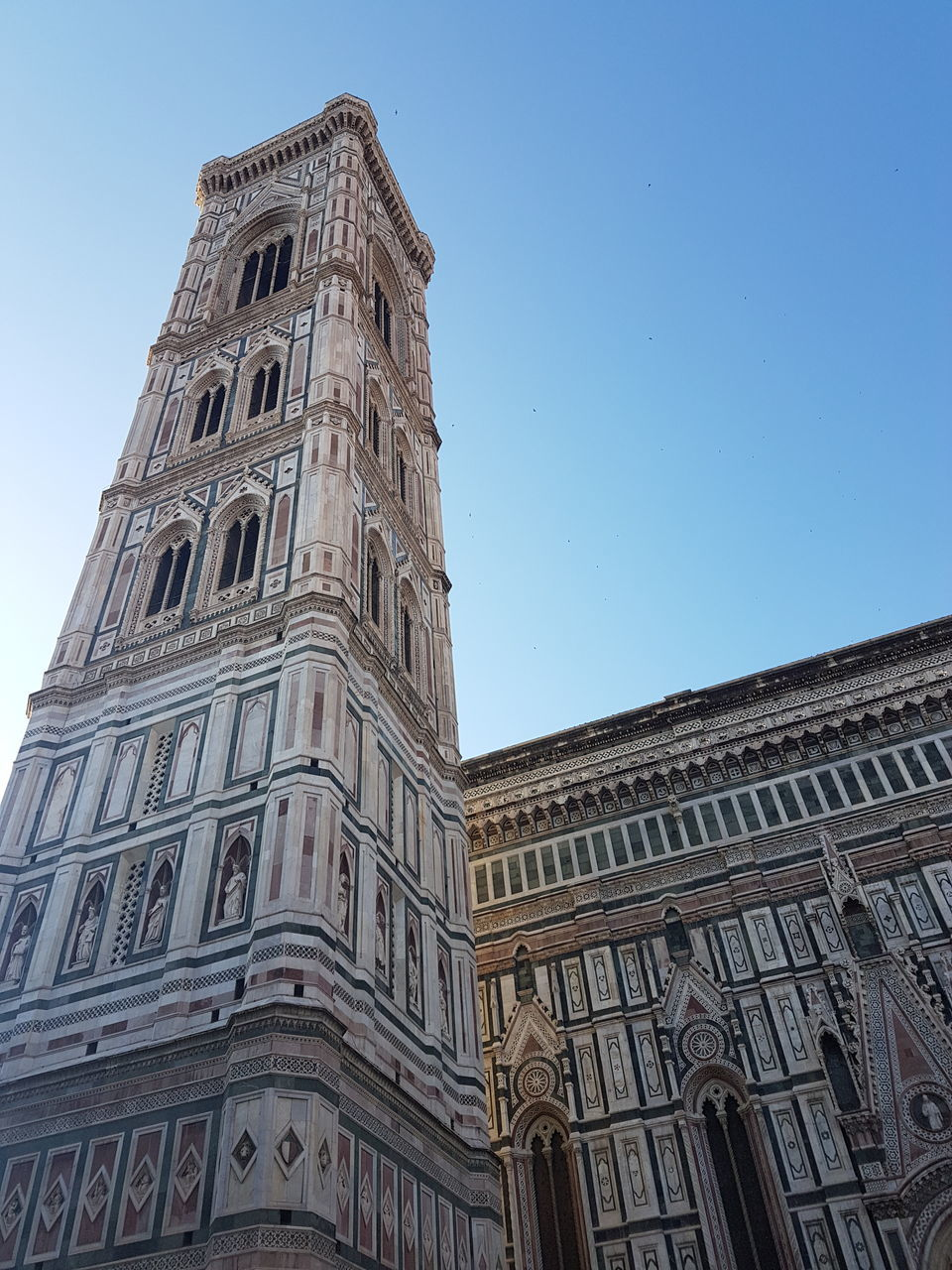 architecture, low angle view, built structure, building exterior, history, religion, day, tower, travel destinations, outdoors, place of worship, no people, sky, spirituality, clock tower, blue, clear sky, clock