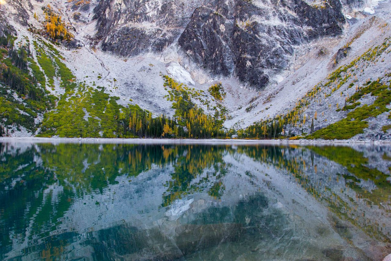 Autumn reflection. Colchuck Lake, the Enchantments, Washington State Adventure Autumn Autumn Colors Beauty Beauty In Nature Blue Cold Temperature Exploring Green Hiking Lake Majestic Mountain Mountain Range Nature Non-urban Scene Outdoors Reflection Scenics Tranquil Scene Tranquility Trees Water Wilderness Yellow