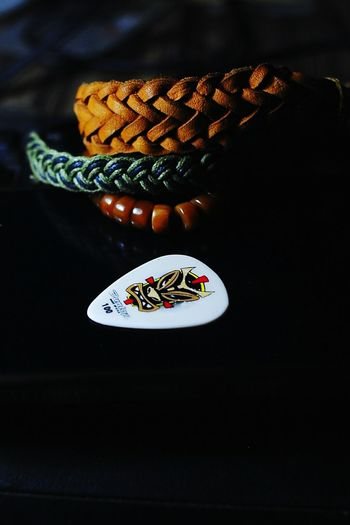 Guitar Pick Craft Crafting Ripcord Paracord Bracelet Still Lives Indoors  Product Photography Dark Photography Lowlightphotography Lowlight Scenic