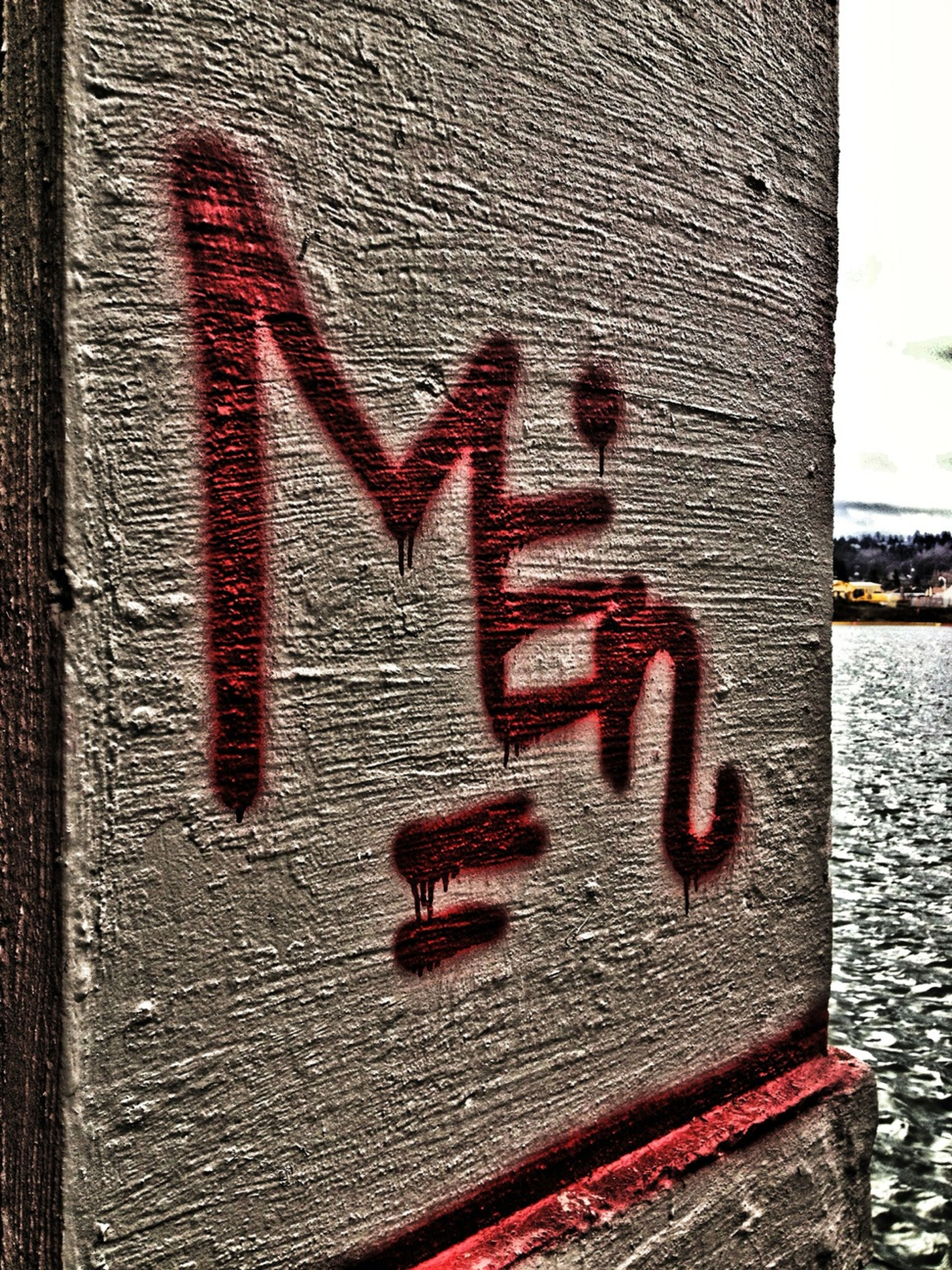 text, communication, western script, red, close-up, textured, wall - building feature, capital letter, sign, built structure, creativity, architecture, wall, art, graffiti, love, day, heart shape, outdoors, pattern