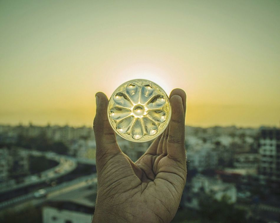 Sunflower? Sunset? Or just a piece of Glass? Human Hand Human Body Part Personal Perspective Sky Holding Focus On Foreground One Person Outdoors Close-up Day People EyeEmBestPics EyeEm Nature Lover EyeEm Best Shots EyeEm Gallery EyeEm Best Shots - Nature EyeEm Best Edits EyeEmNewHere Looking At View Sunflower Sunset Glass Glass - Material