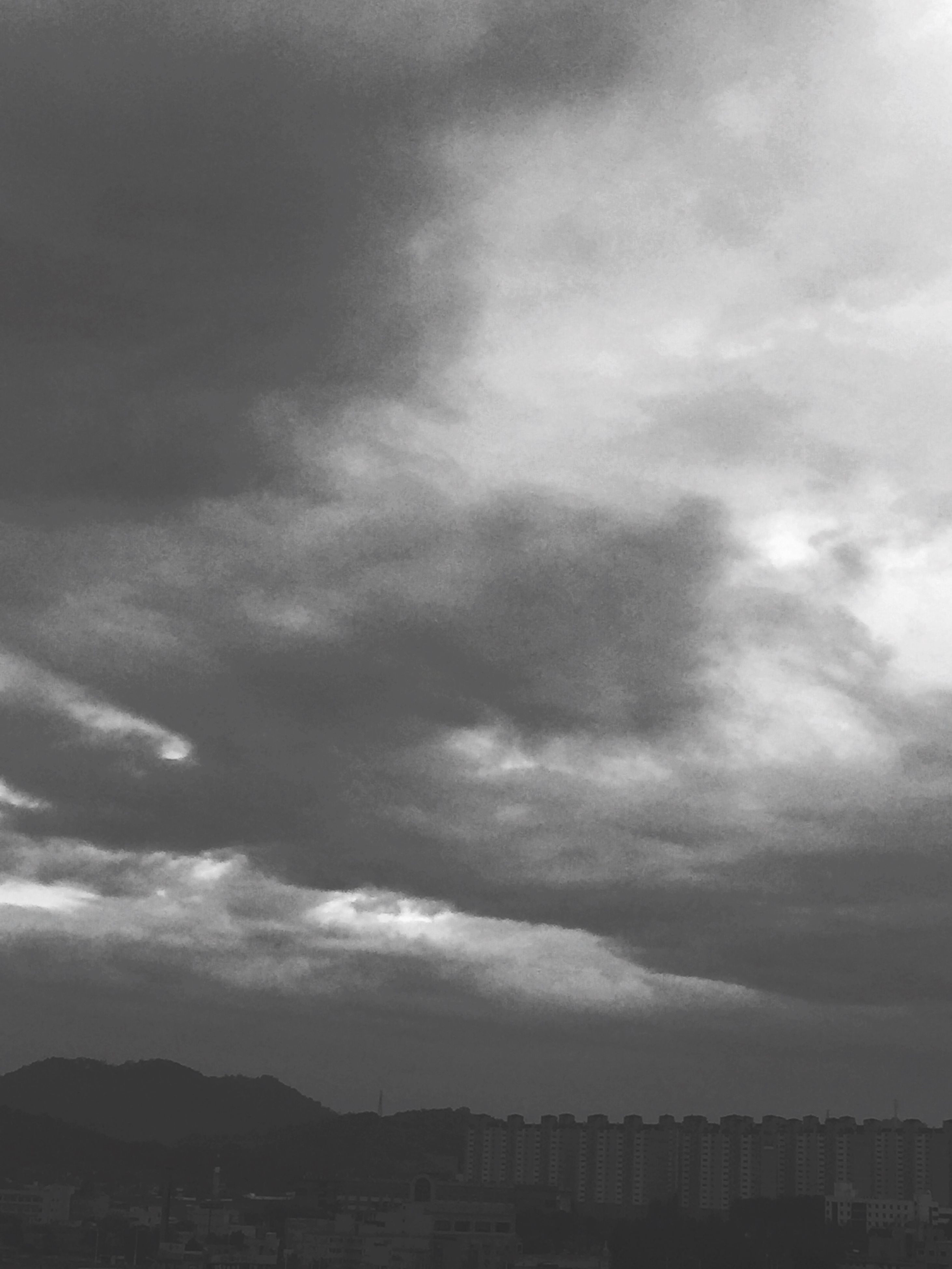 sky, cloud - sky, building exterior, architecture, built structure, cloudy, weather, mountain, overcast, cloud, scenics, nature, beauty in nature, city, house, dusk, residential structure, residential building, outdoors, cloudscape