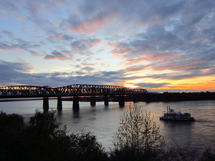 Sunset Beauty Old Bridge Mississippi River Ferryboat Sky And Clouds Colors Of Earth Natures Beauty Naturelover❤ NoEditNoFilter In Awe Of Nature Childlikesenseofwonder Absolutely Beautiful Nature Bridgelove Memphis,tn
