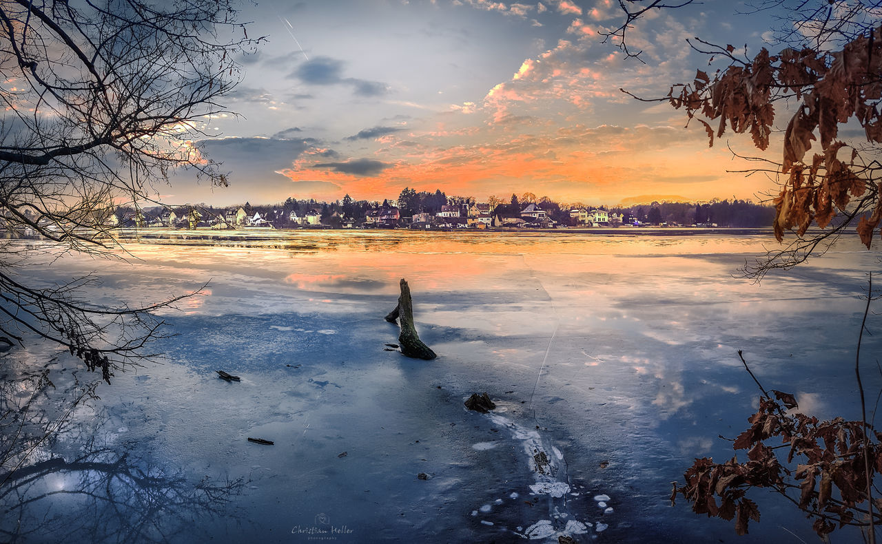 Fire & Ice Beach Beauty In Nature City Cold Temperature Day Nature One Person Outdoors People Postcard Reflection Sky Snow Sunset Travel Destinations Tree Vacations Water Winter