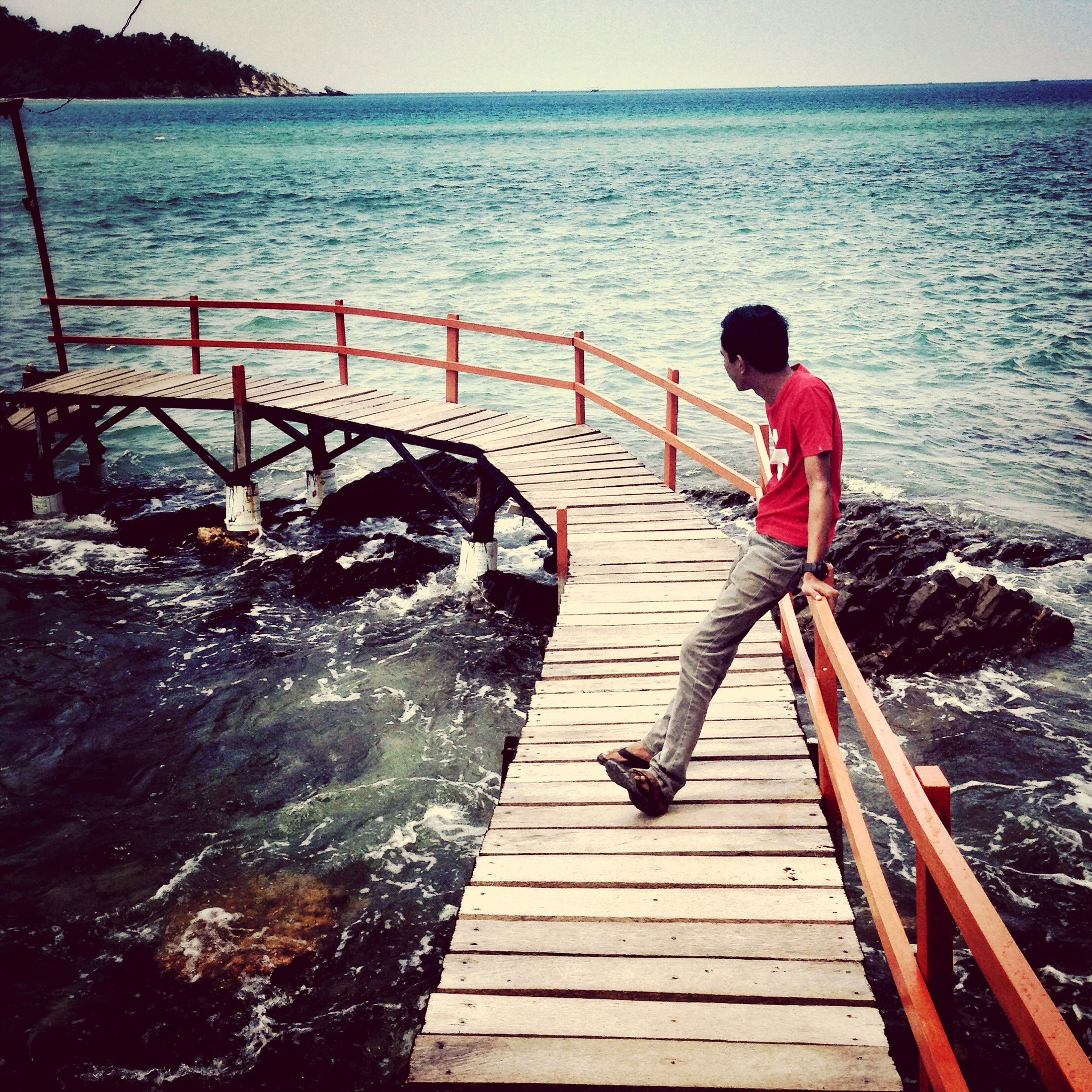 water, sea, full length, railing, lifestyles, leisure activity, pier, rear view, men, high angle view, nature, vacations, horizon over water, childhood, steps, standing, scenics, day